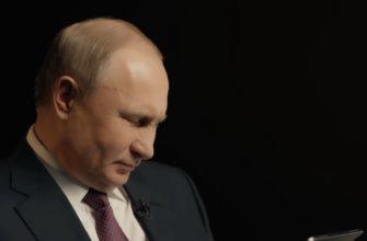 Владимир Путин на черном фоне.