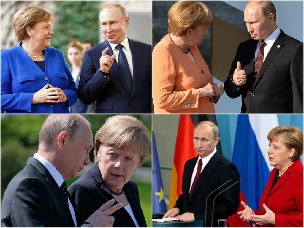 На фото Путин и Меркель.